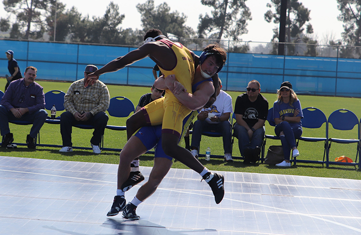 Wyatt+Gerl+getting+ready+to+slam+his+Arizona+State+opponent+in+the+CSUB+Feud+on+The+Field+wrestling+match+versus+Arizona+State+University+held+on+the+main+field+Sunday%2C+February+16th%2C+2020.