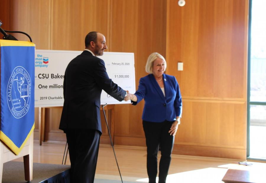 President of Cal State Bakersfield, Lynnette Zelezny, thanking William Lacobie, vice president for Chevron's San Joaquin Valley Business Unit, for the gift of $1 million at Walter W. Stiern Library Dezember Reading Room held on Feb. 25th, 2020.