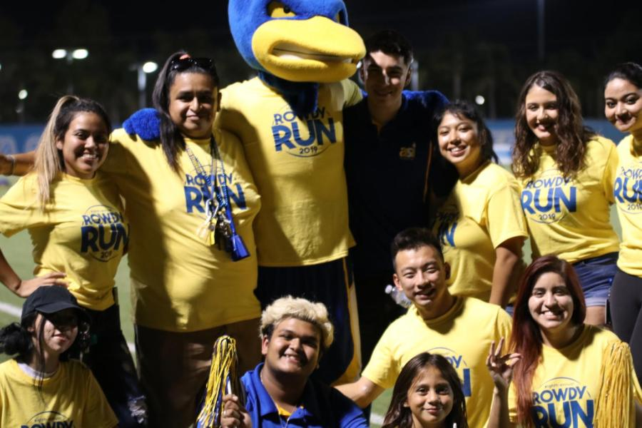 Some of our ASI members pose with our runner mascot after the Rowdy Runner Event for the Freshman Class of 2023 during the women's soccer game that happened Friday September 6,2019.