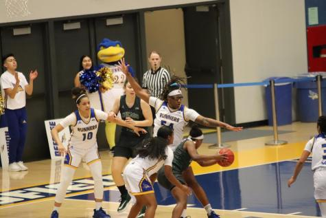 Junior Vanessa Austin blocks Grand Canyon player during the game agains Grand Canyon on Saturday Mar. 7