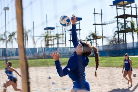 CSUB senior Jazleigh Ortiz hitting the ball overhead during beach volleyball practice.