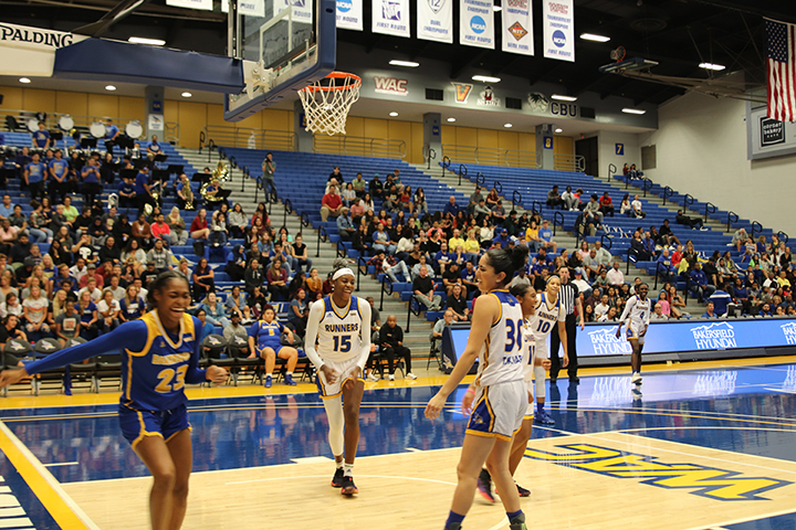 CSUB freshman IYanna Lops, sophomore Miracle Saxon, and redshirt-junior Kate Tokuhara all celebrating during the blue-and-gold game on  Oct. 22, 2019