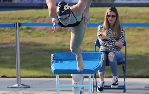 Freshman Mikayla Popham dives to start out meet against UC Santa Cruz on Saturday Jan 11.