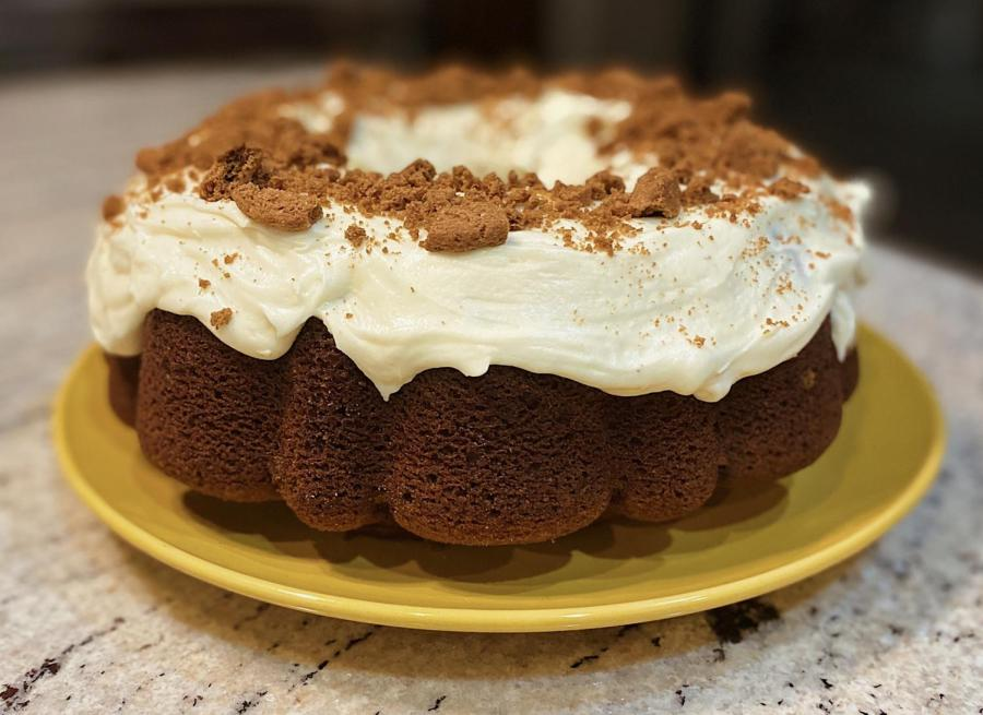 Top the cake with crumbled cookies to perfect this fall treat!