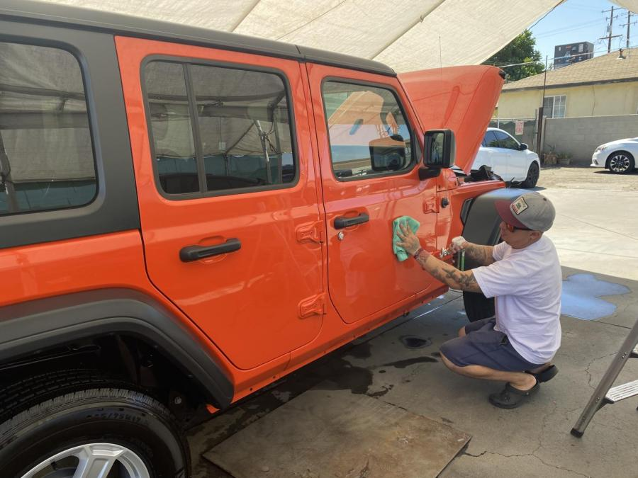 Alexsandro Hernandez details a customers Jeep at his shop at 700 Wible Road Bakersfield, California.