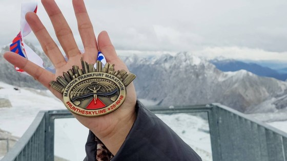 running medal in the snow