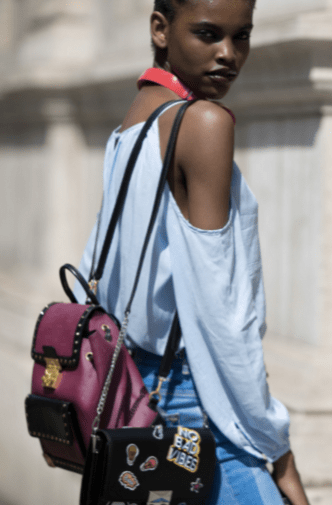 It girl and hot list model Amilna Estevao embraces the cold shoulder with a chambray top and burgundy backpack. It's perfection at its finest.