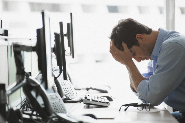 Tired office worker --- Image by © Hiya Images/Corbis