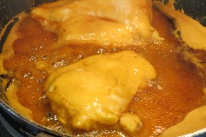 Cooking chicken in the sauce