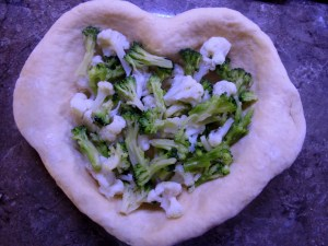 Filling the tart with the broccolli