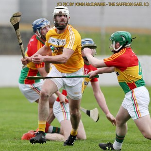 Christy Ring Cup Senior Hurling - Carlow v Antrim at Netwatch Dr Cullen Park. Antrim's Neill McManus in action against Carlow's Gary Bennett during Saturday's Christy Ring opener in Carlow Pic by John McIlwaine