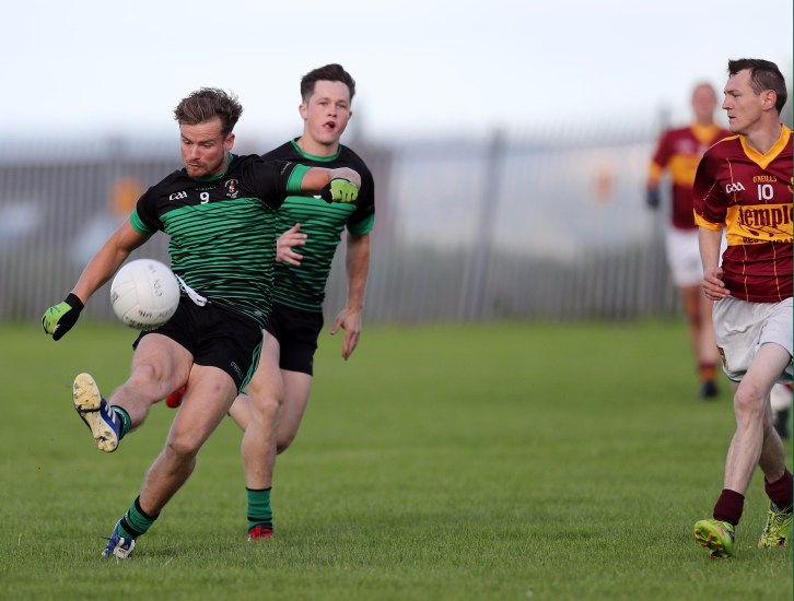 Sarsfields Kevin McKernan sends over a point during Friday evening's JFC win over O'Donnell's at St Teresa's