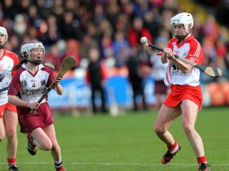 Loughgiel's Charlene Campbell sends over a point during her team's win over Slaughtneil. Pic by Dylan McIlwaine