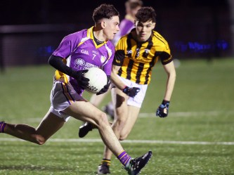 Derrygonnelly Harps Cian Corrigan in action along with Crossmaglens Oisin Doyle in yesterdays FonaCAB Ulster Minor Football championship at Colilaste Feirste Belfast