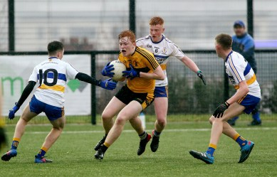 St Eunans Ronan Mc Geehin in action along with Errigal Ciarans Pauric Taylor with Michael Quinn and Tiernan Colhoun in yesterdays FonaCAB Ulster Minor Football championship at Colilaste Feirste Belfast