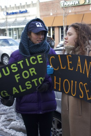 """Protesters outside of Coolidge Corner Theater hold signs including ones with the words """"Clean House."""" According to protesters, this phrase refers to the goal of taking elected officials who protestors say perpetrated alleged racism out of office."""