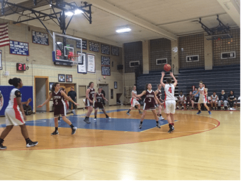 Girls basketball beats Dedham handily
