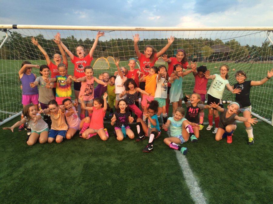 Members+of+the+girls+varsity+soccer+team+volunteer+and+coach+younger+Brookline+players+at+Skyline+Park+in+South+Brookline.+