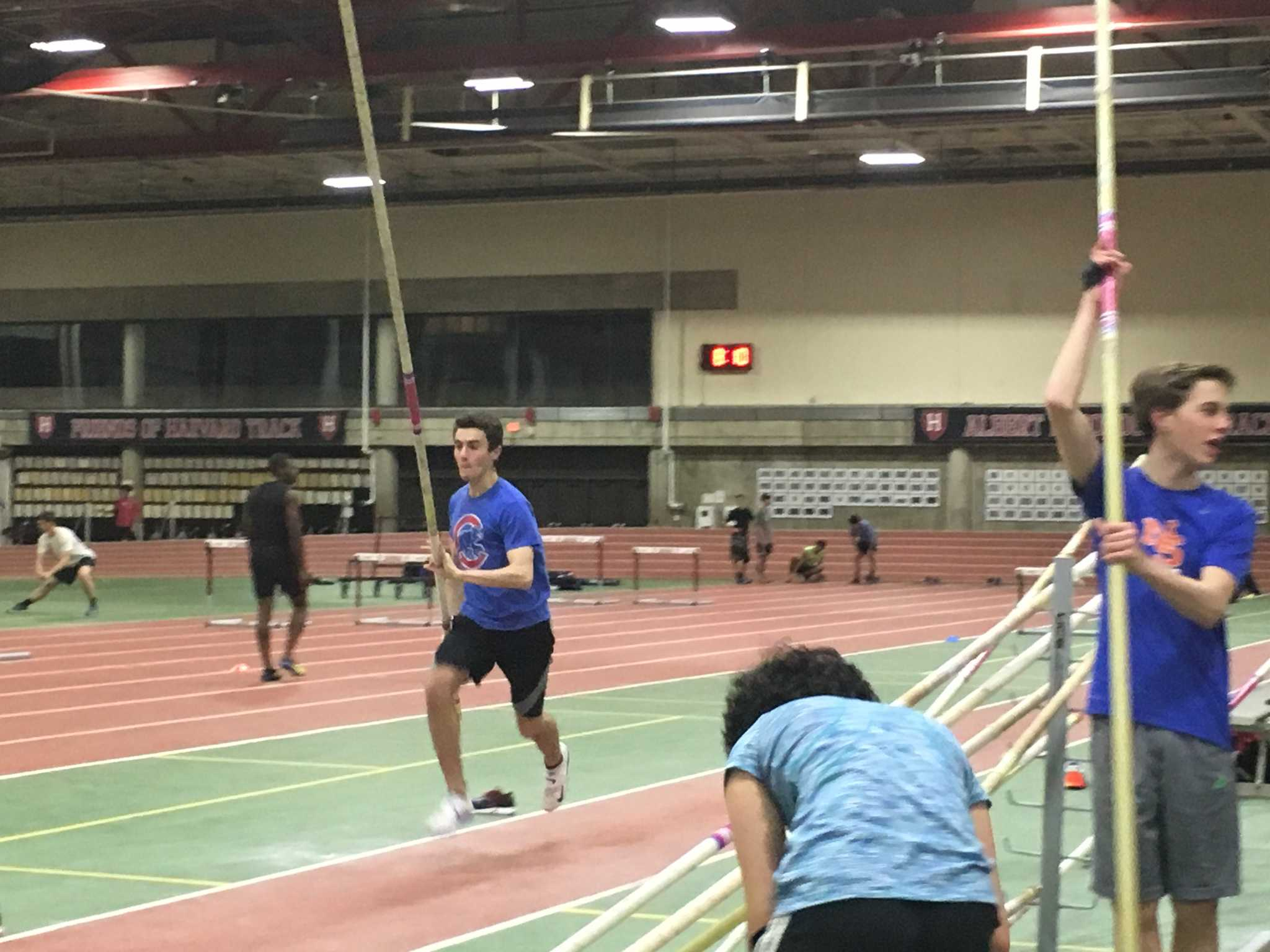 Junior Nick Collins practices his event of choice, pole vault, at Harvard University, after a high school practice.