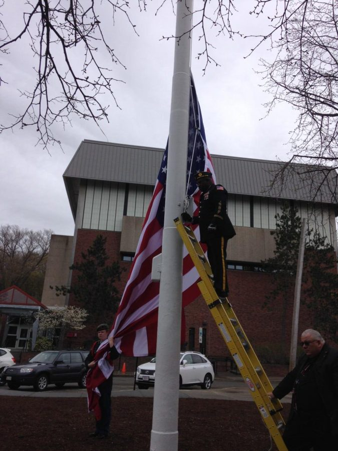 Elmon+Hendrickson%2C+Commander+of+the+Brookline+American+Legion+Post+11%2C+raising+the+U.S.+flag.%0A