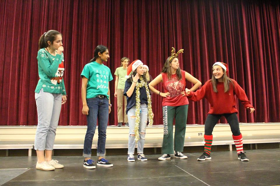 Happy holidays! Needs Improvment members (from left to right) juniors Clara Levrero, Damini Gopal, Emma Grinspoon, Lexi Matuson and Ceci Cipullo leave the audience chuckling.