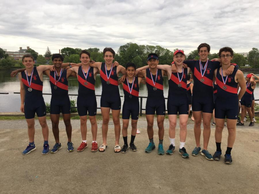 The+boys+varsity+crew+team+poses+following+the+Mass+Pubs+regatta+in+Lowell%2C+MA.+According+to+junior+Eric+Jamous%2C+many+rowers+start+crew+their+freshmen+year%2C+which+pushes+the+athletes+to+work+even+harder+because+they+all+start+with+the+same+skills.+