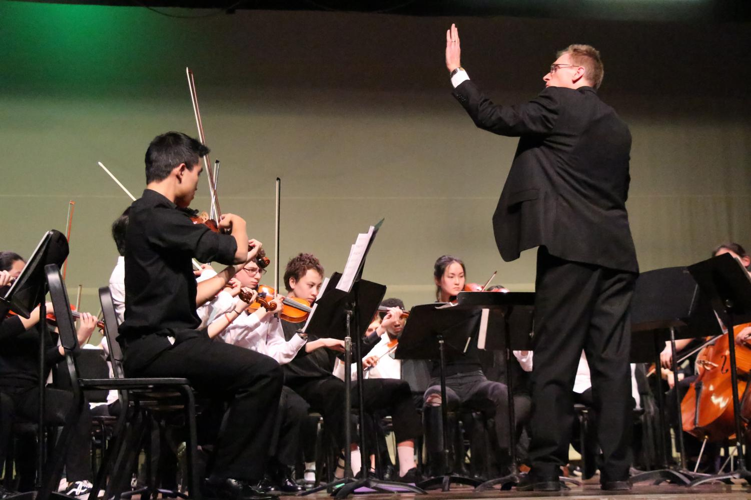 John Ferguson conducts the combined orchestras for