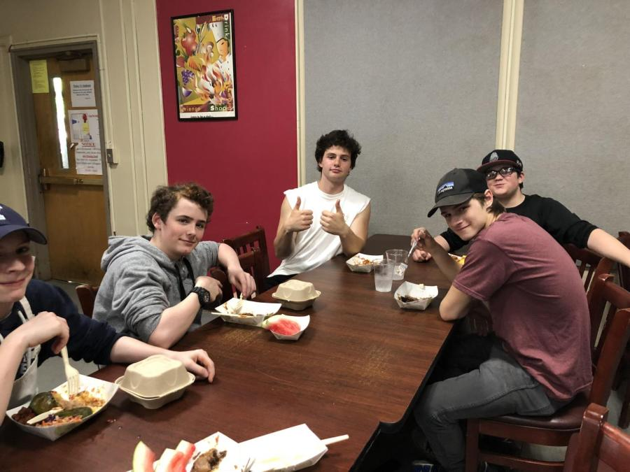 Freshman+Jonah+Lenoch+%28along+with+junior+Lucas+Mitchell%2C+sophomore+Alexander+McDowell+and+freshman+Bobby+Southward%29+eats+after+cooking+a+barbeque-themed+menu+for+Top+Chef.%0ALenoch+followed+a+family+tradition+of+celebrating+the+Fourth+of+July+with+barbecue.