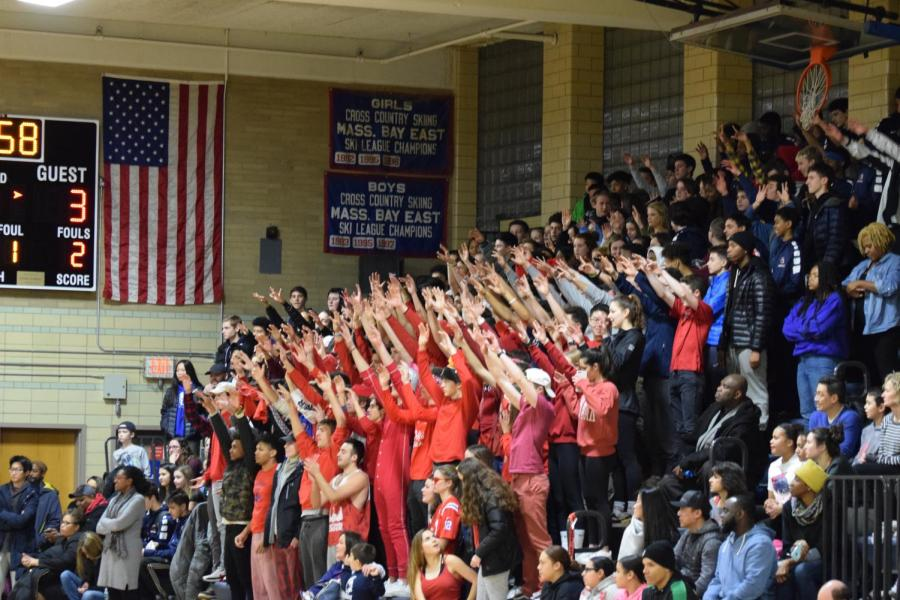 The+crowd+of+students+and+family+members+cheer+on+the+team+during+a+boys+varsity+basketball+game.