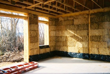 Straw bale wall under construction.