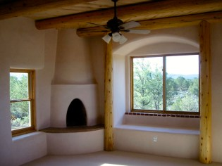 Kiva fireplace with bumped out daybed in the Master Bedroom.