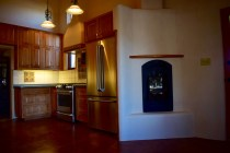 Custom Alder Wood Kitchen with gas fireplace.