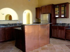 Kitchen island with copper back.