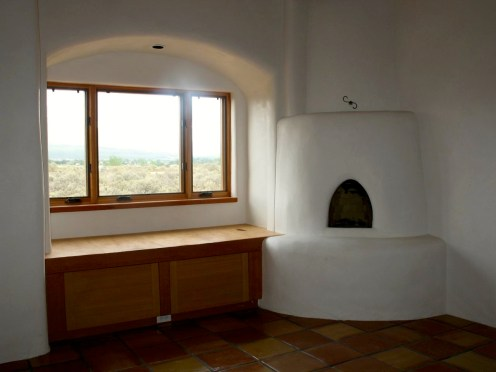 Kiva fireplace with recessed daybed in Master Bedroom.