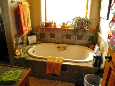 Master Bathroom with oval bathtub and custom tile surround.