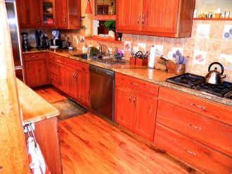 Kitchen with custom Alder cabinetry. Granite counters.