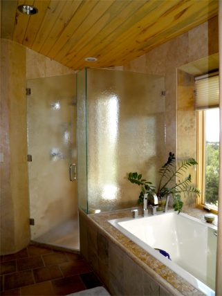 Master bathroom tub and shower.