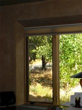 Window detail with flared sides and concrete sill.