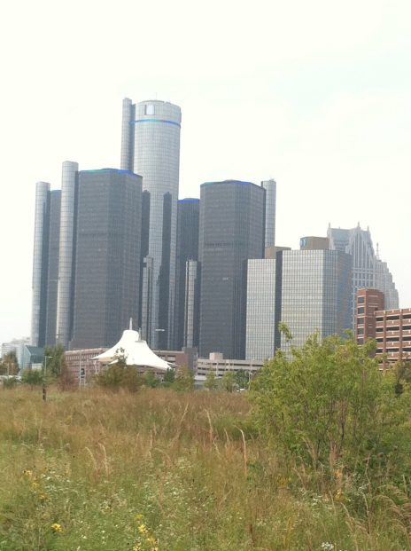 Renessance Center from an overgrown downtown field.
