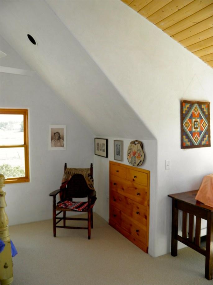 Built-in dresser in second floor bedroom.