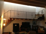 BEFORE: This spindly iron railing also had to go. The open space below was a clutter magnet.