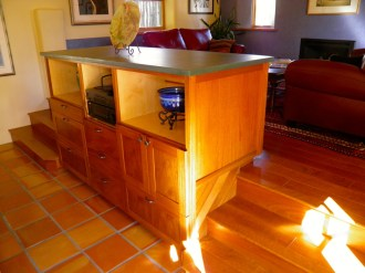 Custom built cabinet serves as a buffet for the dining room.