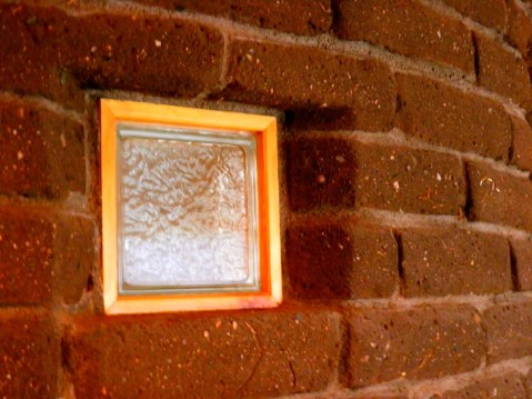 Glass block in Adobe wall.