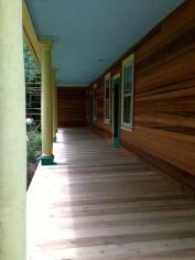 Exterior view with Natural Cedar siding. New Cedar porch.