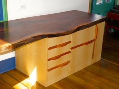 Maple desk with Spansh Cedar pulls. Black Walnut top with a live edge.