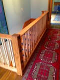 Oak and Maple railing. Near post is reclaimed from the original timber frame.