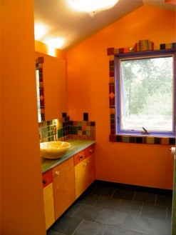 2cnd floor Guest Bathroom with Green Onyx counter top and Pewabic tile window trim.