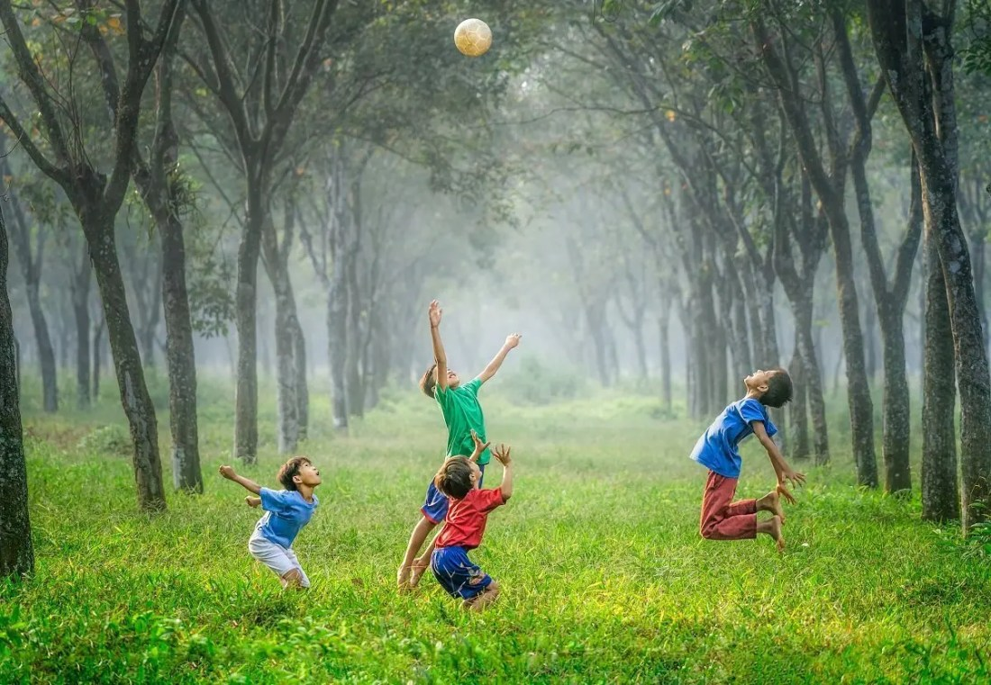 Children Playing Sports Outdoors Safely
