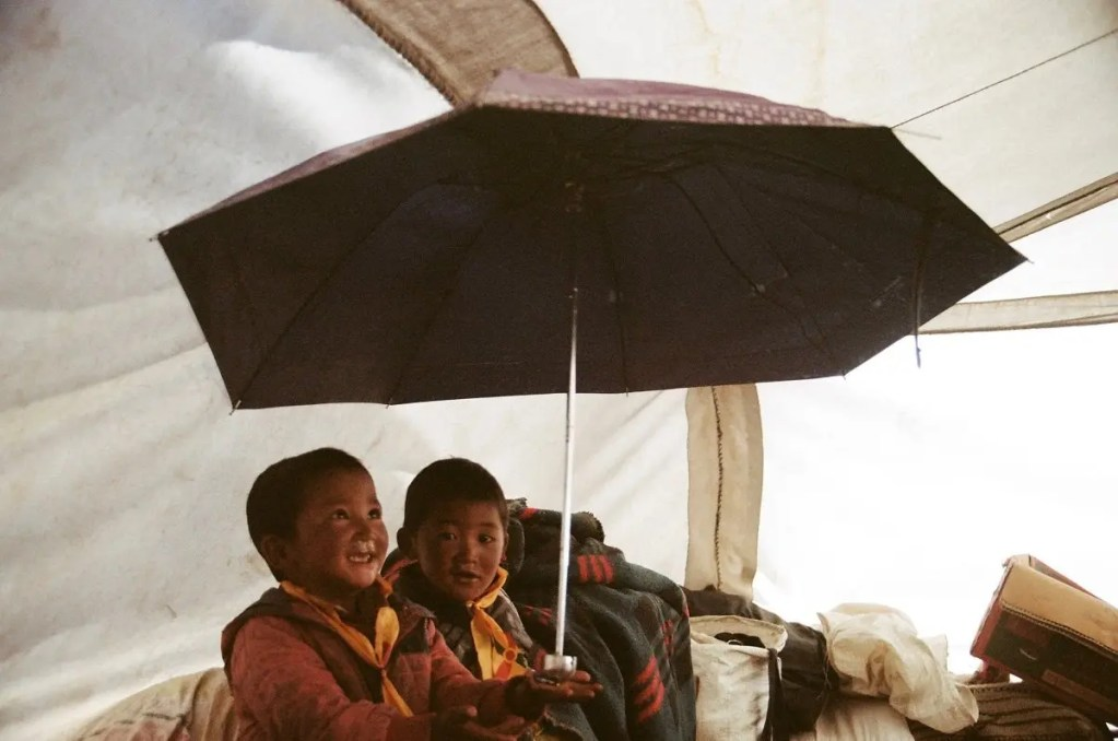 Tibet Children under Umbrella