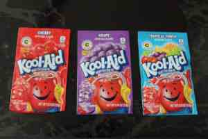 packets of cherry, grape, and tropical punch kool aid